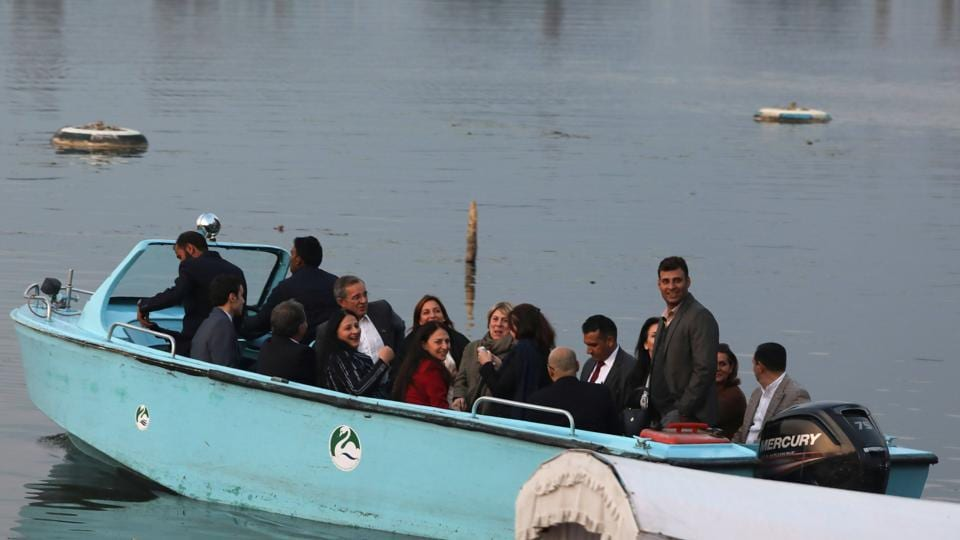 A delegation of European Union lawmakers take a local shikara ride in the Dal Lake, Srinagar, Jammu and Kashmir.