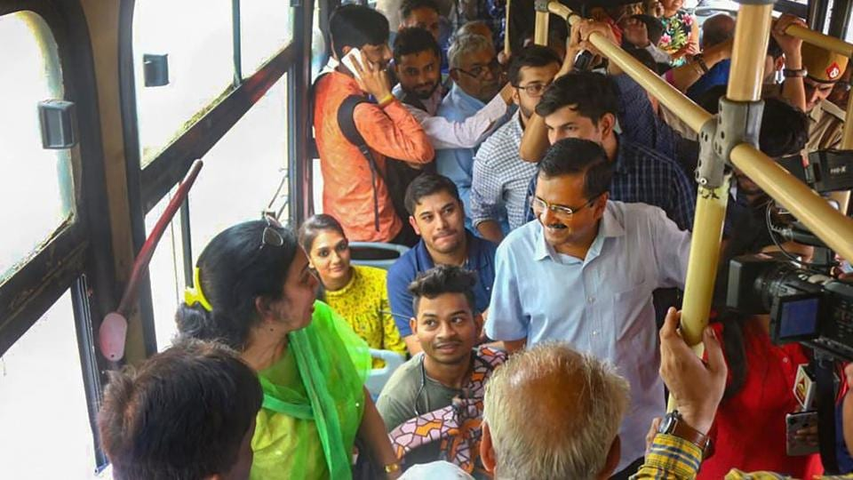 Delhi Chief Minister Arvind Kejriwal interacts with women passengers to get feedback about his government's free-ride scheme, in New Delhi, Wednesday.