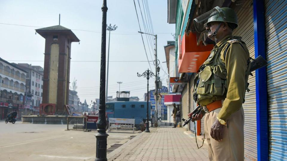 Security personnel stand guard during a shutdown in Kashmir.