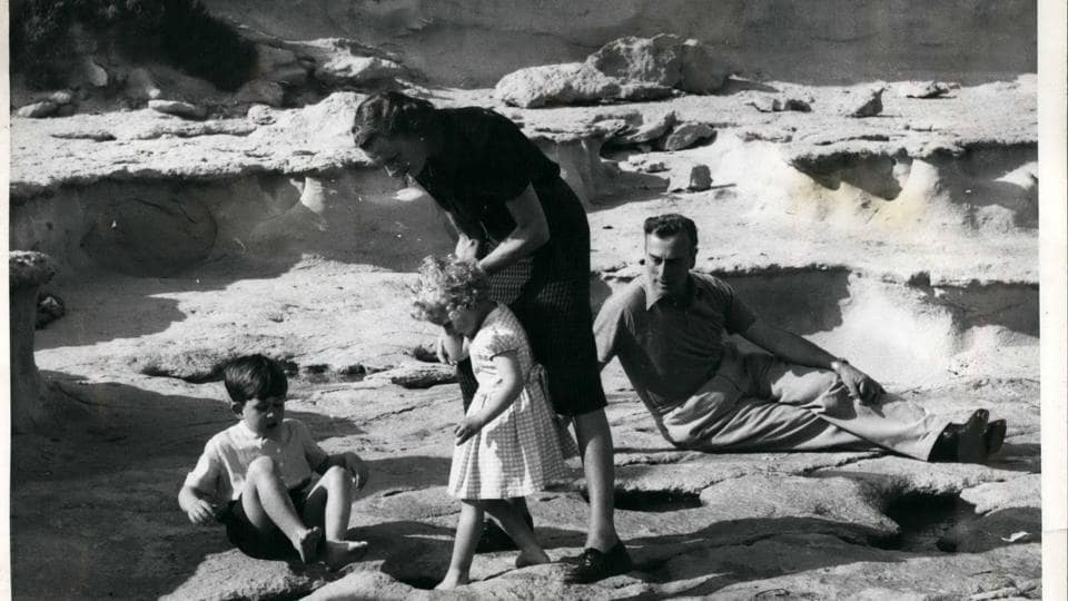 Royal Children in Malta: Lady Mountbatten lends a steadying hand as Princess Anne probes a tempting paddling pool. Elder brother Prince Charles dangles his feet into a pool unaided, but a watchful eye is kept on him by Uncle Dickie - Earl Mountbatten.