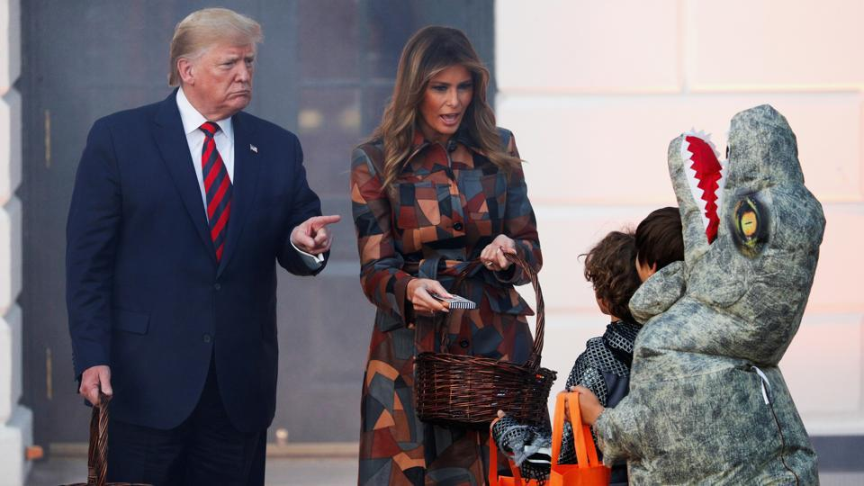 US President Donald Trump and first lady Melania Trump hand out Halloween candy to visiting schoolchildren in advance of Halloween at the White House in Washington. (Tom Brenner / REUTERS)