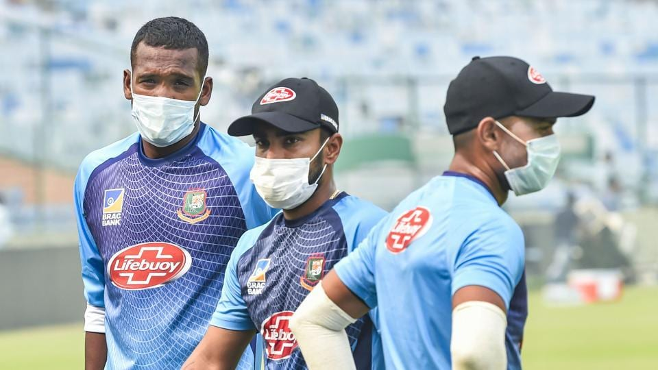 Bangladeshi cricketers Al-Amin Hossain, Liton Das and Abu Hider Rony, wearing masks to protect themselves from air-pollution, during a practice session at Arun Jaitley Stadium in New Delhi. (PTI)
