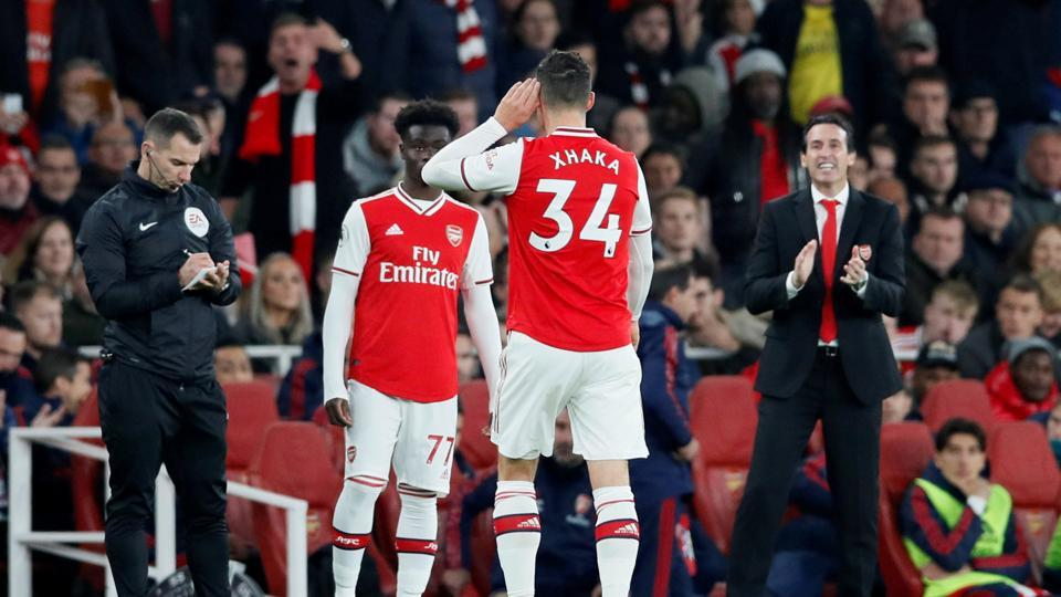 Arsenal's Granit Xhaka gestures to fans as he is substituted.