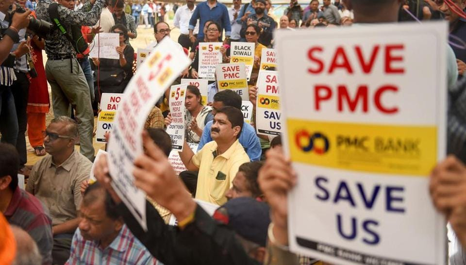 Account-holders in the Punjab and Maharashtra Co-operative Bank (PMC) protest in Mumbai over the Reserve Bank of India (RBI)'s curb on the bank.