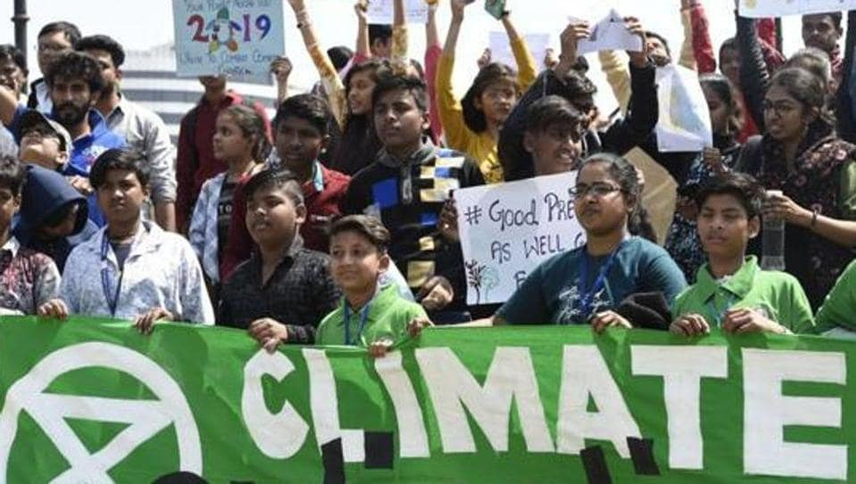 School children hold placards as they participate in a protest against the inaction to curb global warming and climate change, at Central Park, Connaught Place, New Delhi, March 15, 2019