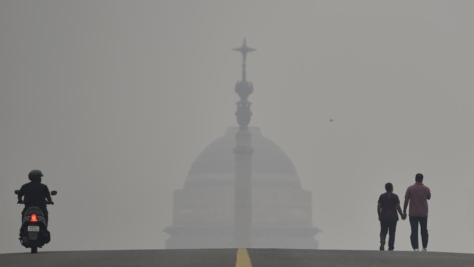 "Rashtrapati Bhavan is seen  at the background amid dense haze and low visibility due to rise in smog. According to officials, people in NCR will need to wait till the weather changes for any relief. ""A western disturbance is approaching and this is expected to trigger some strong surface winds, which in turn would help flush out pollutants. Significant improvement is expected from Sunday onwards,"" said a senior official of Safar. (Burhaan Kinu / HT Photo)"