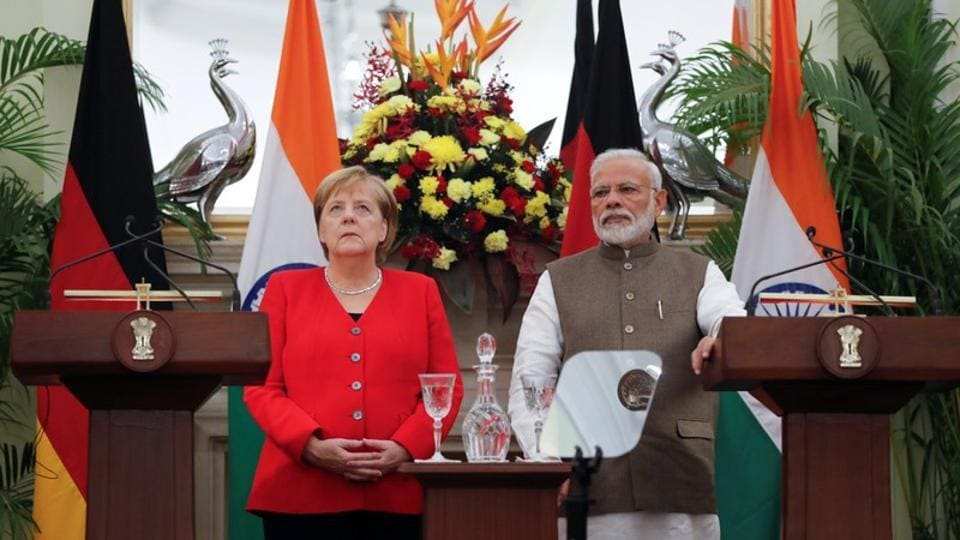 German Chancellor Angela Merkel and India's Prime Minister Narendra Modi are seen before making a joint statement at Hyderabad House in New Delhi.