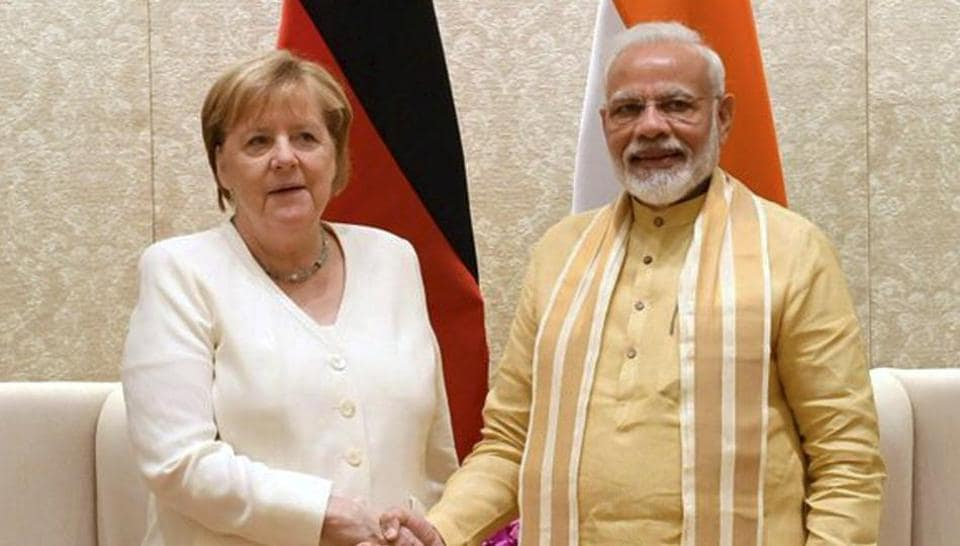 Prime Minister Narendra Modi shakes hands with German Chancellor Angela Merkel at Lok Kalyan Marg in New Delhi.