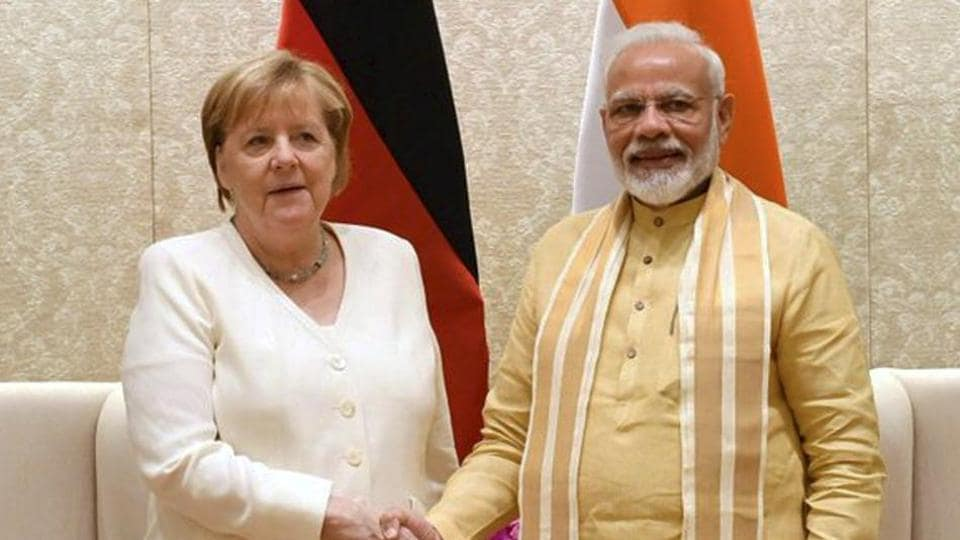 Germany's Angela Merkel said Germany will spend one billion euros ($1.12 billion) in the next five years on green urban mobility projects conceived under the new German-Indian partnership.