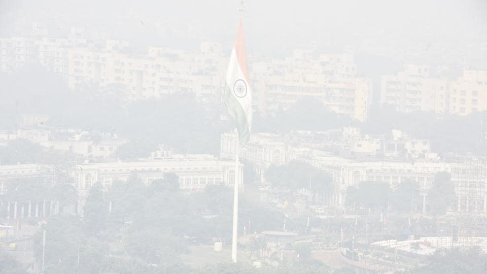 A view of the Central Park engulfed in heavy smog right after the night of Diwali celebrations, at Connaught Place. The Epca also ordered a complete ban on construction work, firecracker use, and activities of polluting industries such as stone-crushers. The order came amid growing criticism of the response mechanism — the Graded Response Action Plan (Grap) — and a rule that says escalating curbs will apply only when pollution has been severe for more than 48 hours. (Sonu Mehta / HT Photo)