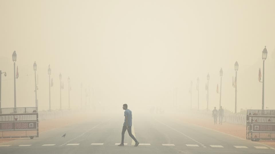 "A man walks past the India Gate engulfed in heavy smog, at Rajpath. According to the Central Pollution Control Board's (CPCB) 4pm bulletin, Delhi's average air quality index (AQI) was at 484 — up from 410 the day before — while the concentration of PM2.5 and PM10 dust particles crossed ""emergency"" thresholds at midnight. In Noida, the AQI was 499, while it was 496 in Ghaziabad and 469 in Gurugram. (Biplov Bhuyan / HT Photo)"