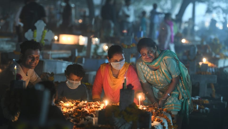 People pay their respects at graves on the Occasion of All Souls Day at Indian Christian Cemetery, Nehru Bazar, Pahar Ganj, in New Delhi, on Saturday, November 2, 2019.