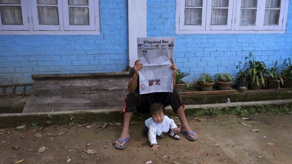 A man reads a newspaper carrying headlines of the Naga peace talks in Kohima, Nagaland. Various Naga groups are currently holding talks with the Indian government with hopes of finding an honorable solution to their demand for self-determination. The Indian government has ruled out the possibility of a separate constitution and a Naga flag as demanded by the NSCN (IM), the largest rebel group. (Yirmiyan Arthur / AP)