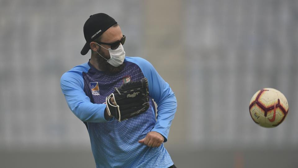Bangladesh cricket team Bowling Coach Daniel Vettori is seen wearing a face mask due to poor air quality, during a practice session ahead of the first T20 international cricket match between India and Bangladesh, at Arun Jaitley Cricket Stadium, in New Delhi. (Burhaan Kinu /HT Photo)