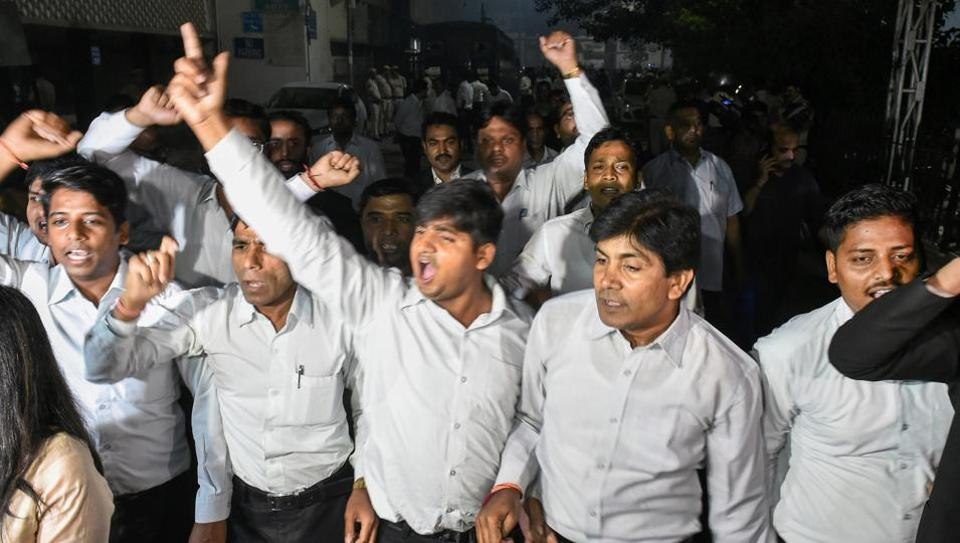 Lawyers raising slogans at Tis Hazari Court complex after clashes between lawyers and police personnel, in New Delhi on Saturday.