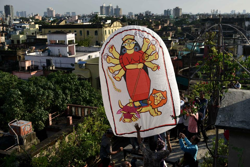 A paper-made hot air balloon (popularly known as 'Fanush') made by PK Mullick, painted with Durga from Kusum Smriti , on the occasion of Diwali/ Kali Puja, at Beadon street, in Kolkata, West Bengal. Though the art of fanush-making is a dying, in the recent years, fanush has become an integral part of Kolkata's Kali Puja celebrations. The air inside the fanush is heated by a cloth rag ball (locally called Luti) soaked in spirit. The Luti is then attached to the base of the fanush.  (Samir Jana / HT Photo)