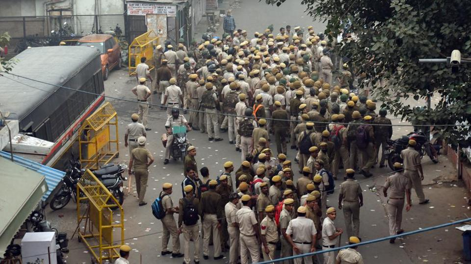 Delhi Police personnel inside  New Delhi's Tis Hazari Court Complex after a dispute over parking in the afternoon escalated into a violent clash  between police and lawyers.