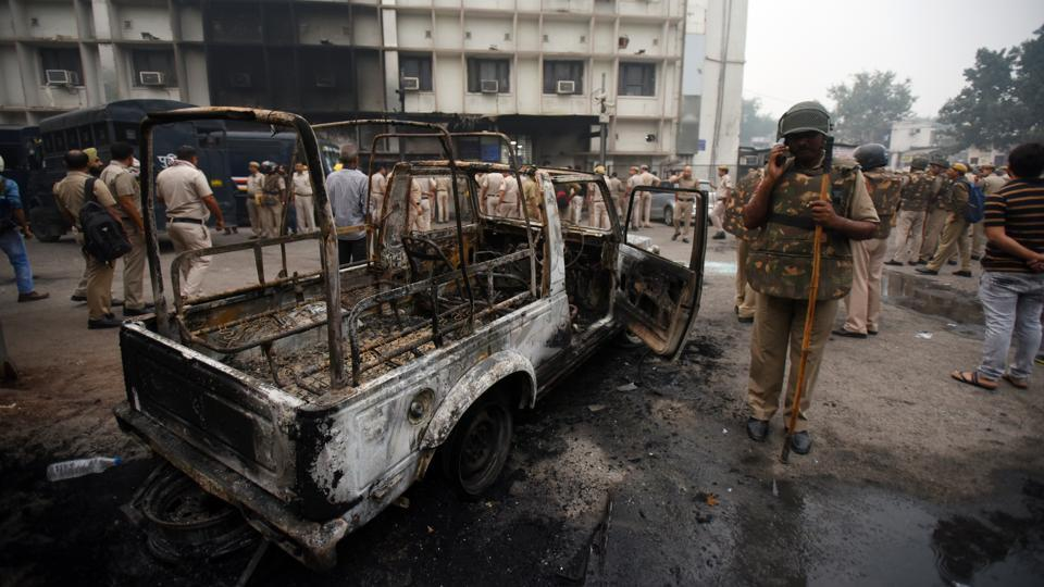 A burnt police vehicle inside the Tis Hazari Court Complex after a dispute over parking in the afternoon escalated into a full-blown clash between the police and the lawyers, in New Delhi. (Amal KS / HT Photo)