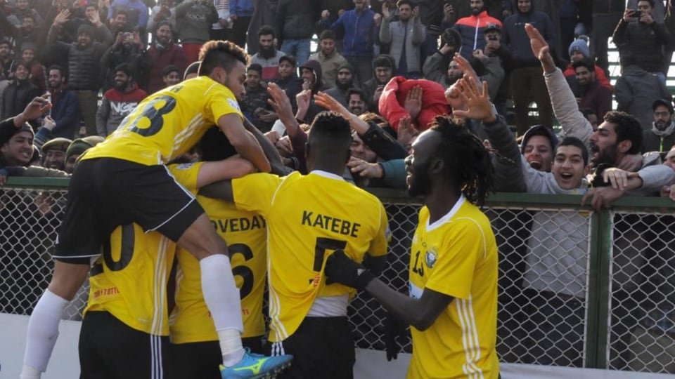 Players of Real Kashmir FC celebrate.