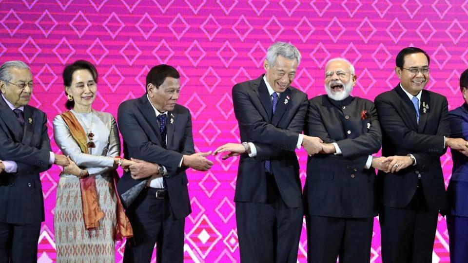 Prime Minister Narendra Modi laughs next to Singapore Prime Minister Lee Hsien Loong at the ASEAN-India Summit