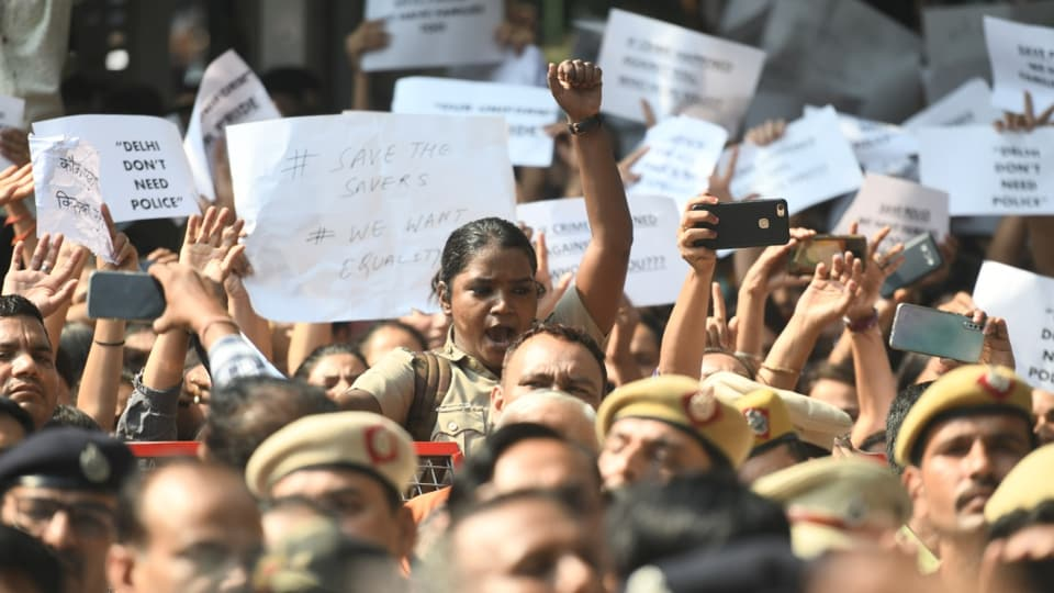Delhi police personnel shout slogans outside the police headquarters over 'handling' of clashes with lawyers in New Delhi, India, on Tuesday, November 5, 2019. (Photo by Raj K Raj/ Hindustan Times)