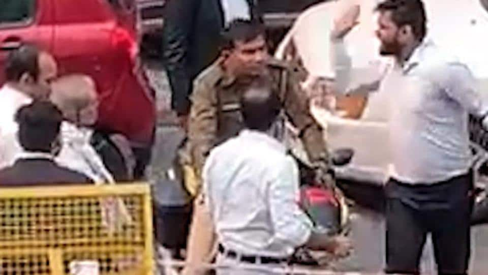 A video grab of lawyers allegedly attacking a cop on Monday during a strike called by lawyers' association to protest  clashes that followed an alleged parking row with police at Tis Hazari.