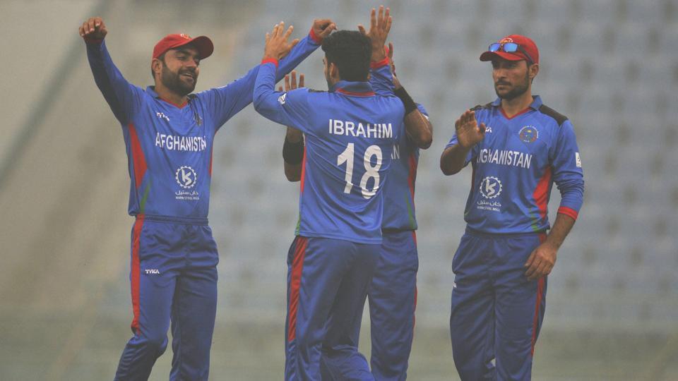 Afghanistan cricket team celebrates after taking a wicket of West Indies player Kieron Pollard.