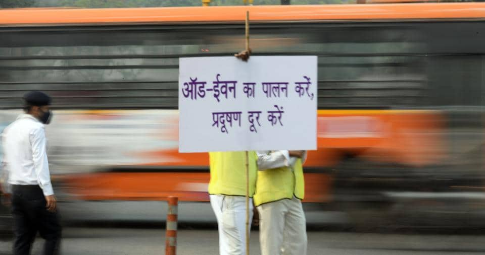 Volunteers from Civil Defence wearing anti pollution masks seen with placards at Laxmi Nagar crossing, in New Delhi. The third edition of the odd-even road space rationing drive saw fewer prosecutions on Monday compared to the first day of the previous arrangement in April, 2016. The Delhi government said since it was the first day of the drive, officials were asked to go soft on violators and instead make them understand about the rule.  (Raj K Raj / HT Photo)