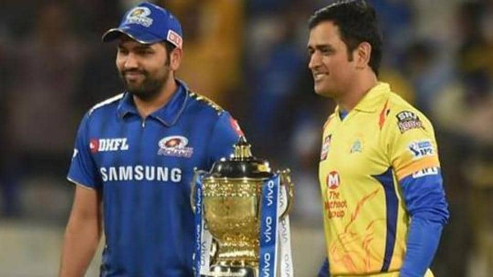 Rohit Sharma (L) and MS Dhoni pose with the IPLtrophy.