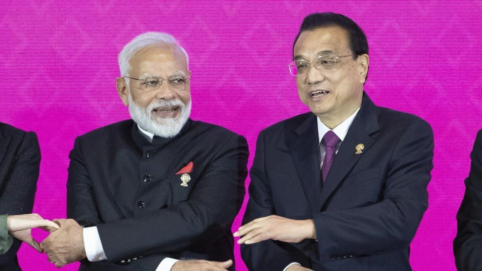 Prime Minister Narendra Modi, left, and Chinese Premier Li Keqiang pose for a group photo at The Regional Comprehensive Economic Partnership Association of Southeast Asian Nations (ASEAN) summit inThailand.