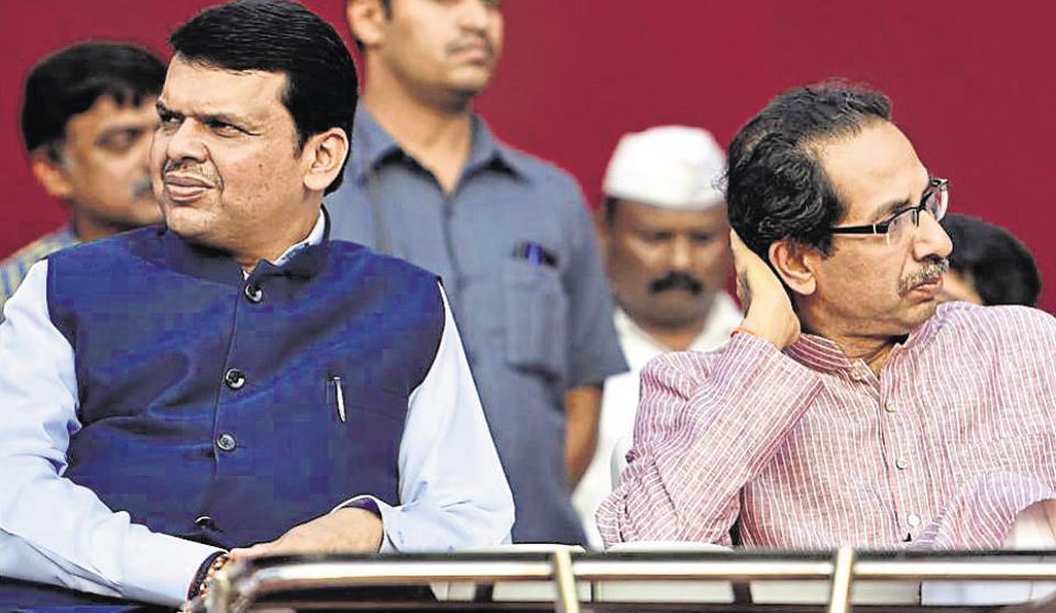 Maharashtra chief minister Devendra Fadnavis and Uddhav Thackeray at a function in  Mumbai on April 30, 2016.