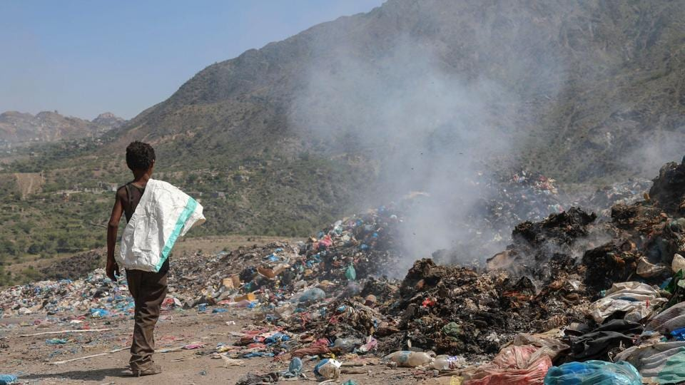 A Yemeni youth walks away carrying a bag to fill with material picked at a large garbage dump in the third-largest city Taez in southwestern Yemen. Mounds of stinking garbage line the streets of Yemen's historic city of Taez, once renowned as one of the most beautiful places in the country, but now torn apart by war. The city in the highlands of southwestern Yemen has become a breeding ground for mosquitoes as well as deadly outbreaks of diseases like cholera, as decaying refuse leaches into waterways. (AHMAD AL-BASHA / AFP)