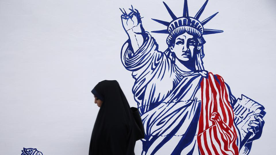 A woman walks in front of new murals of the former US embassy in Tehran, Iran November 2, 2019.  (VIA REUTERS)