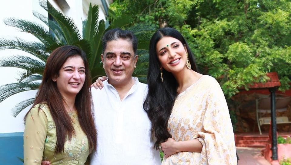 Kamal Haasan poses with his daughters.