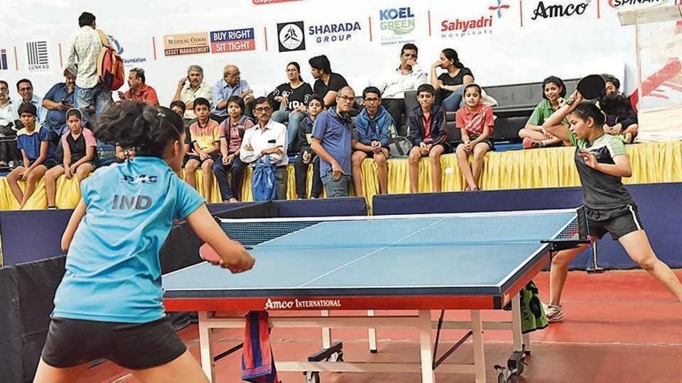 Diya Chitale (green-black) in action at the 81st Maharashtra State Table Tennis Championship at Balewadi  on Wednesday.