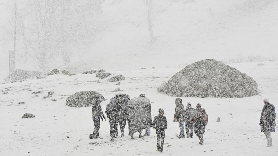 People walk during first snowfall in Sonamarg some 90 kilometers from Srinagar, Jammu and Kashmir,  on Wednesday, November 6, 2019.