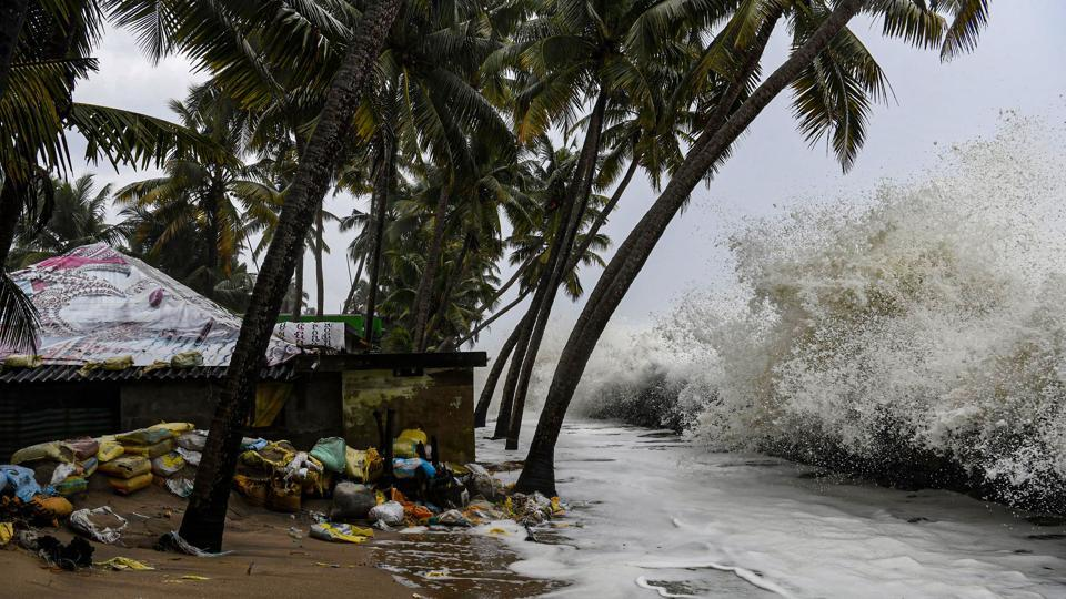 Sea waves crash close to a habitation in Chellanam area of Kochi  on October 31, 2019. Severe cyclonic storm 'Maha' may not hit the Gujarat coast and is likely to fizzle out into the Arabian sea as a 'depression' by Thursday evening.