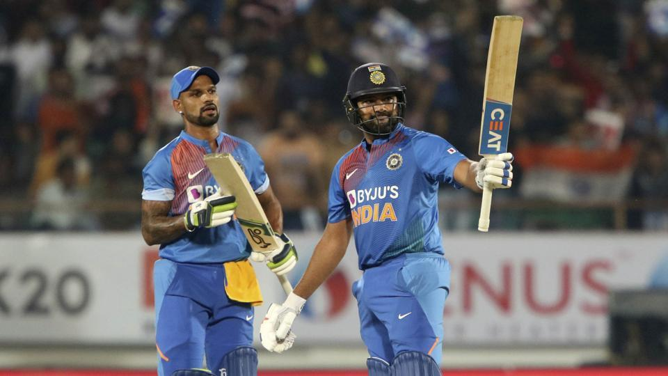 India's captain Rohit Sharma, right celebrates his fifty as Shikhar Dhavan looks on. (AP)