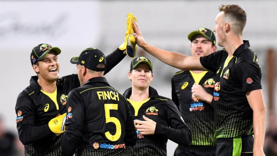Australian players celebrate after the fall of a wicket.