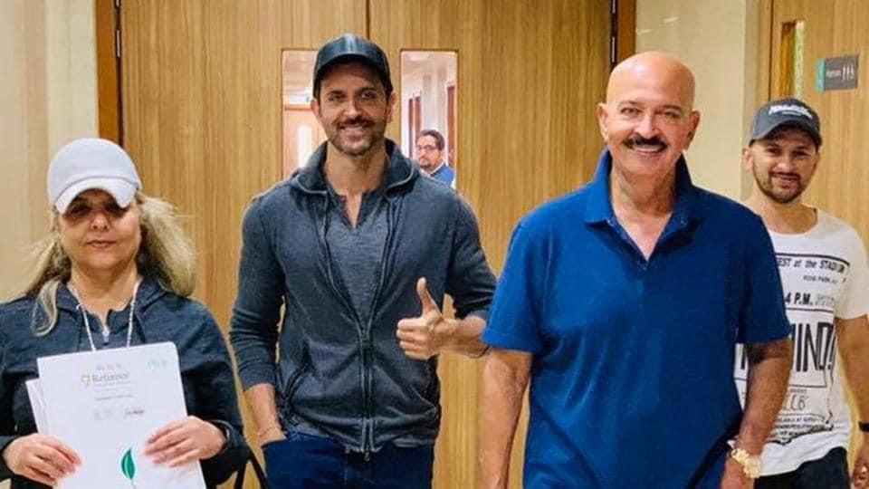 Hrithik Roshan accompanies his dad Rakesh as he steps out o the hospital.