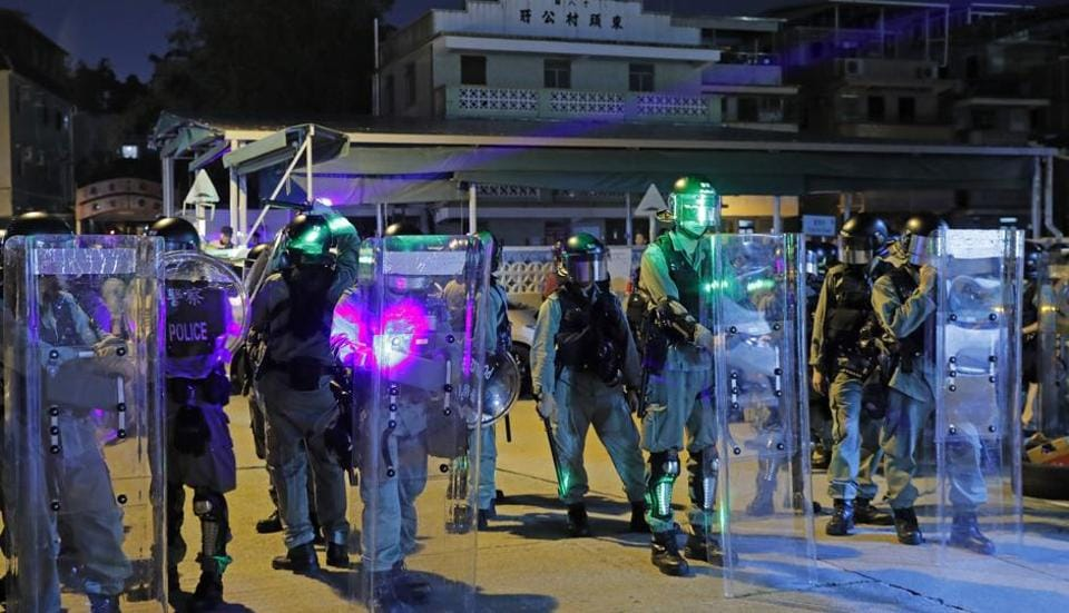 """China has slammed radical protesters in Hong Kong as """"mobsters"""" using violence to influence upcoming local elections, after a pro-Beijing lawmaker was injured in a stabbing."""