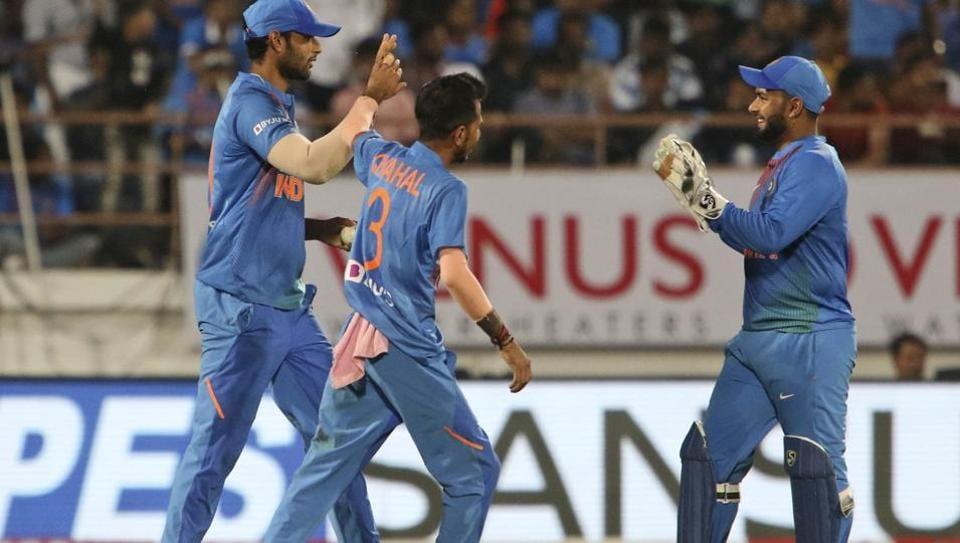 Indian players Deepak Chahar, left, Yuzvendra Chahal, center and Rishabh Pant