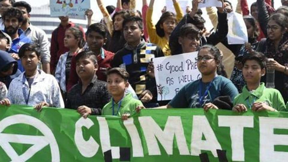 School children hold placards as they participate in a protest against the inaction to curb global warming and climate change,  Connaught Place, New Delhi, March 15, 2019
