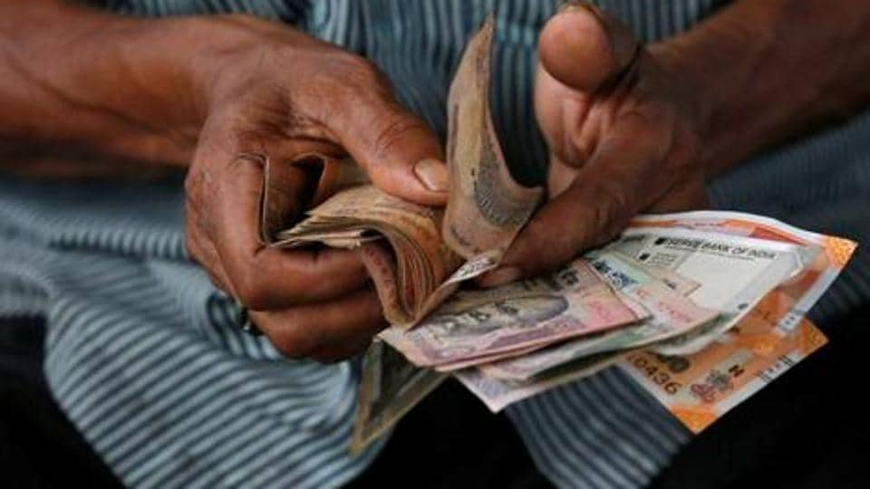 Rupee declined the most in Asia, while sovereign bonds and stocks saw modest losses after Moody's Investors Services lowered the nation's rating outlook to negative citing growth concerns.