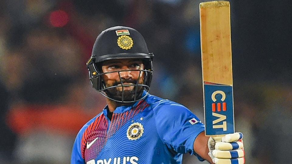 India's stand-in captain Rohit Sharma raises his bat after scoring 50 runs during the second T20 cricket match against Bangladesh at Saurashtra Cricket Association Stadium in Rajkot, Thursday, Nov. 7, 2019.