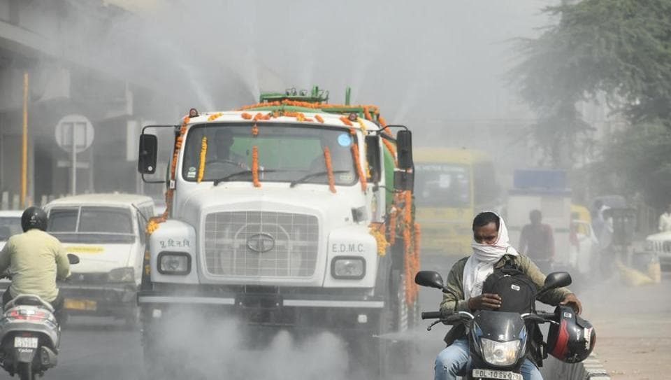 File photo of an EDMCwater tanker sprinkles water on NH-24  near Anand Vihar, in New Delhi.  Anand Vihar is among the 13 hot spots in Delhi where the air is noxious at most times of the day.