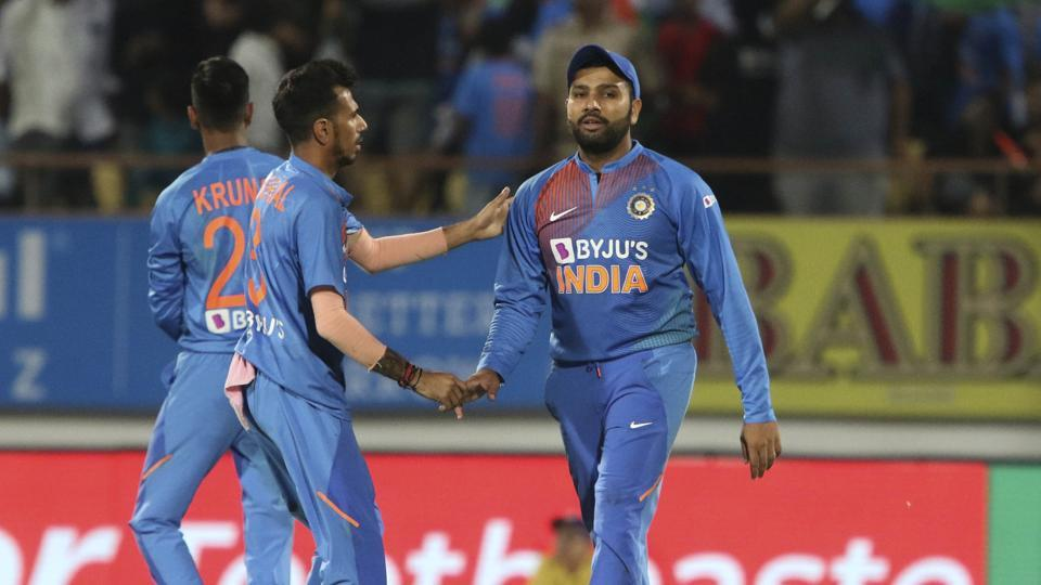 Indian player Yuzvendra Chahal congratulates Rohit Sharma who took a catch to dismiss Bangladesh's Afif Hossain during the second Twenty20 international cricket match between India and Bangladesh in Rajkot, India, Thursday, Nov. 7, 2019.