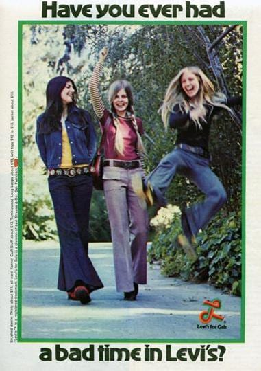 A 1970s Levis ad shows jeans in all colours, flaring wildly below the knee.