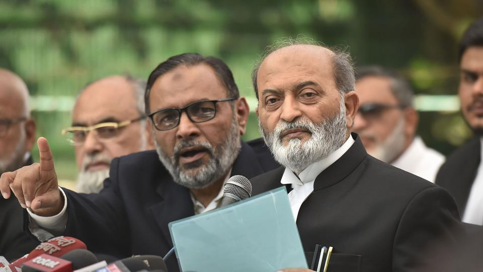 Sunni Central Waqf Board's lawyer Zafaryab Jilani along with other advocates addresses a press conference after the Supreme Court verdict on the Ayodhya case, in New Delhi, Saturday, Nov. 9, 2019.