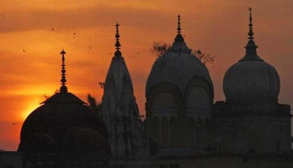 Birds fly at sunset over a Hindu temple on the 20th anniversary of the Babri mosque demolition in Ayodhya.  Photo